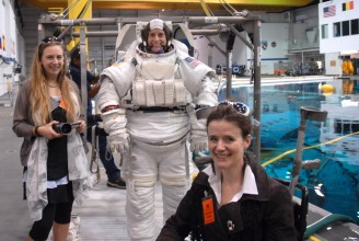 photo of Trish Wheatley and underwater wheelchair artist Sue Austin pictured with astronaut Kate Rubins in her space suit