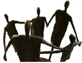 Image of group of bronze figures stood holding hands
