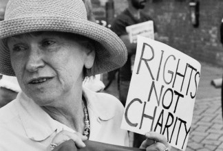 Black and White photograph of Jan Pollock attending an ATOS action